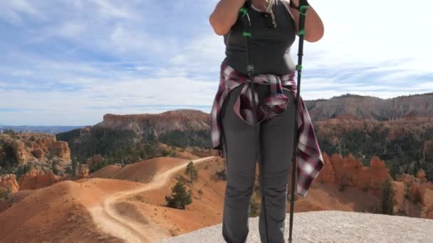 A Woman Takes A Breath And Fixes Her Hair On A Short Respite In The Bryce Canyon