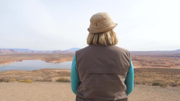 Bottom-Up Mature Woman Tourist Looks On The Valley Of The Canyon In The Desert