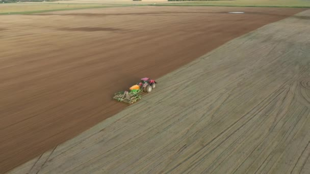 Farmer In Tractor Planting Seeds Of Corn Crops In Agricultural Field Aerial View