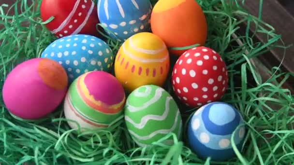 Painted eggs symbolizing Easter over straw green background