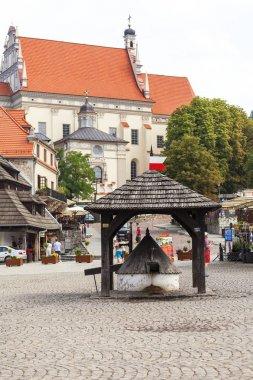 Market in old city of  Kazimierz Dolny at Vistula river, well, Poland