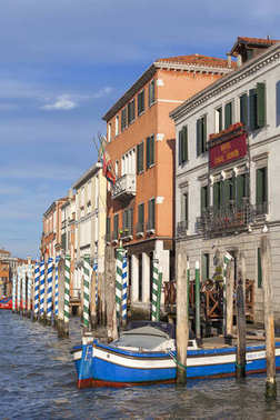 Grand Canal, vintage buildings, parked boats at the marina, Venice, Italy