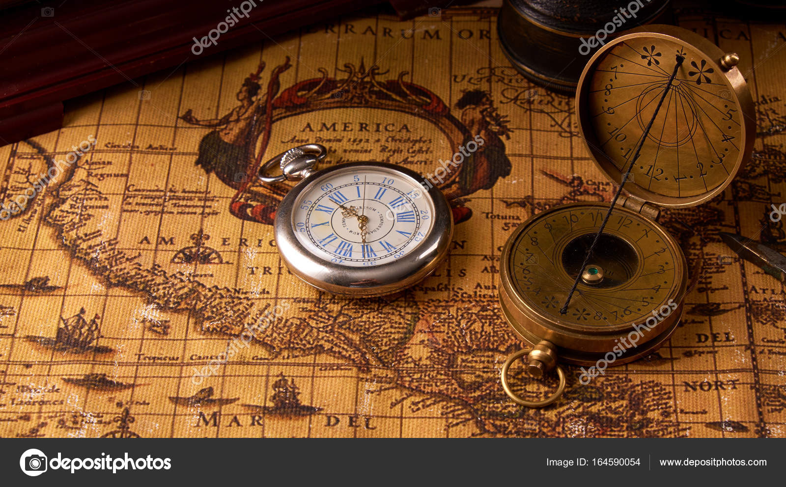 Old vintage retro compass on ancient world map vintage still life old vintage retro compass on ancient world map vintage still life travel geography navigation concept background photo by natusikby gumiabroncs Gallery