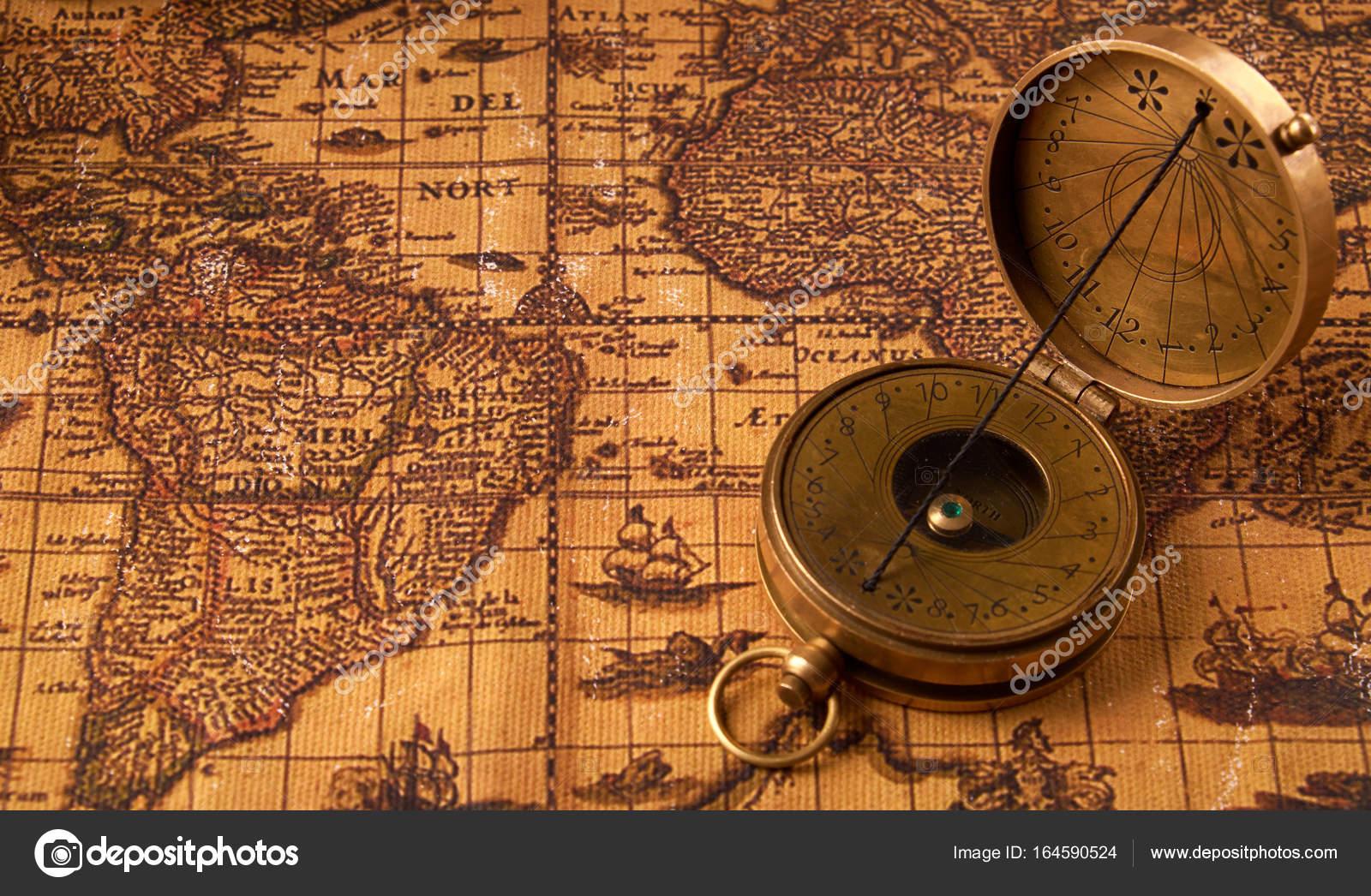 Old vintage retro compass on ancient world map. Vintage still life ...