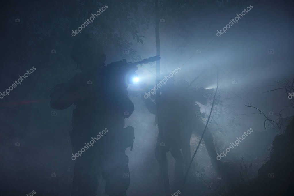 Special Forces soldiers in action. Elite squad moves through fog and smoke. They use special equipment, weapons and tactical devices. stock vector