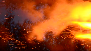 Sparks fire cracks in grill fire pit. Burning ash rise from large fire in the night sky. Summer nights, nature presence. Food porn , and stylish background.