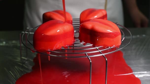 Strawberry icing covered cakes