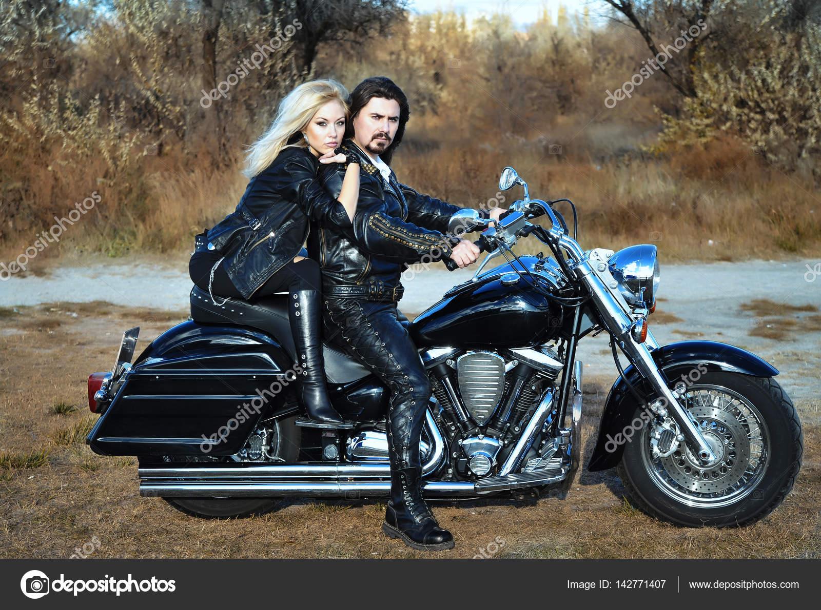 couple on a bike stock photo alenaphoto 142771407