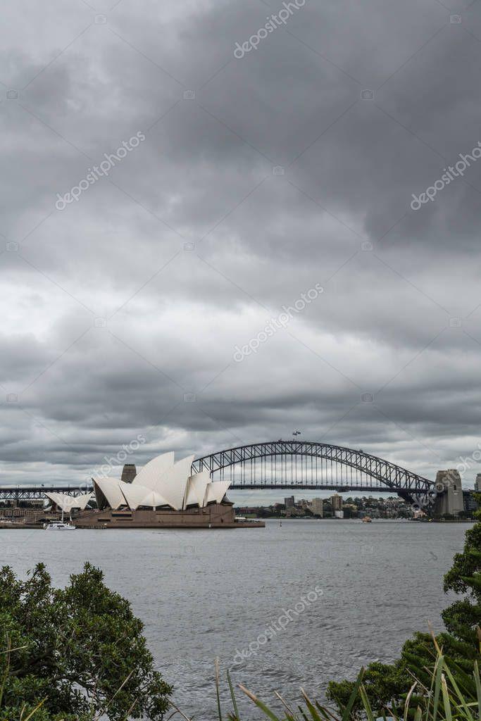 Opera House and Harbour Bridge behind under cloudscape, Sydney A