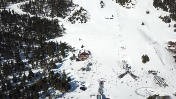 drone footage overlooking the Grandvalira ski resort in Andorra. skiers queuing for the ski lifts