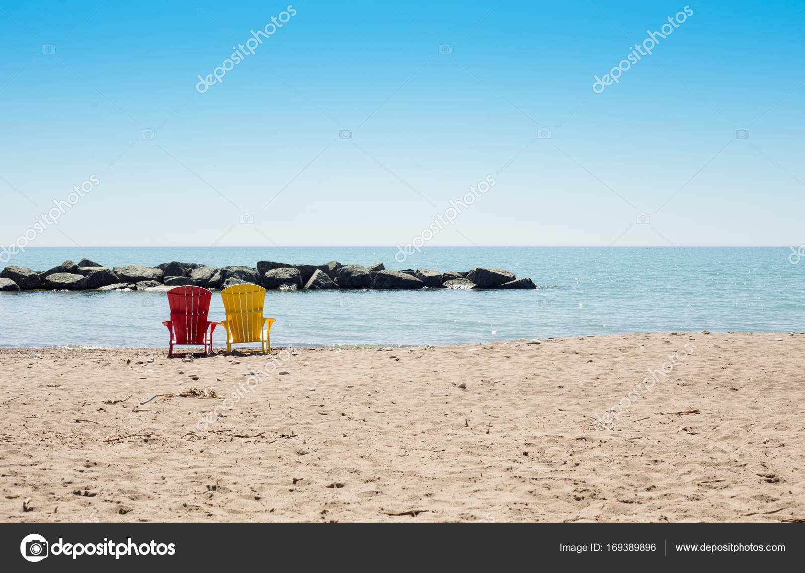 Beach scene with two colorful adirondack chairs — Stock ...