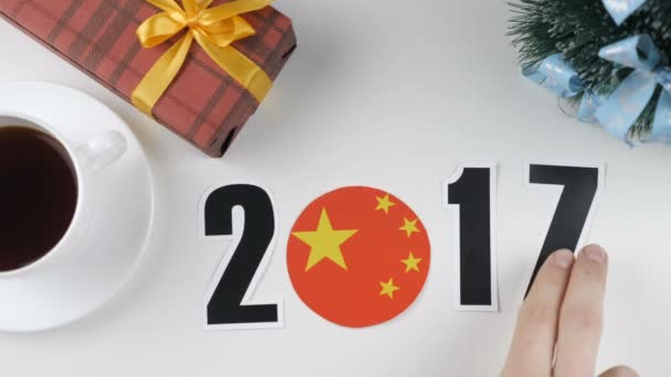 Illustration, new year, male hand changes the year from 2017 to 2018, China flag, cauntry ball.