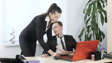 Sexual harassment in the office, the boss flirts with the secretary, the boss looks at the figure of his wedded 60 fps
