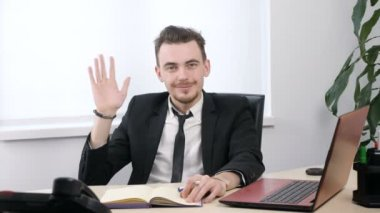 Young businessman in suit showing goodbye sign and and waving his hand 60 fps
