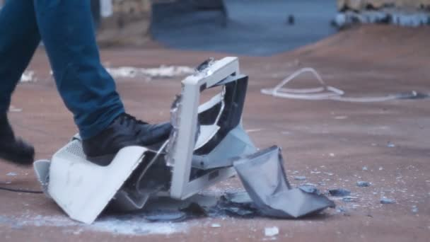 Male feet in shoes destroy the old glass monitor  60 fps