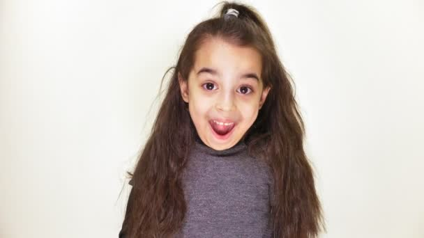 Little cute caucasian girl, smiling, showing an emotion of surprise, wide-open mouth, portrait white background 50 fps