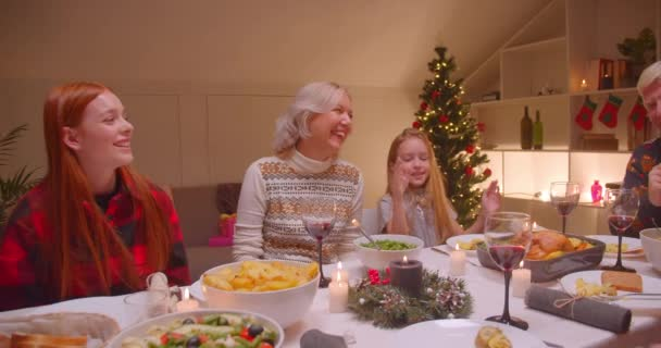 Big family Christmas party sings a song dance fun children granddaughters reunion