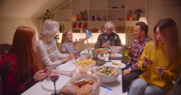 Big family Christmas use smartphones problem do not communicate different generations of Internet