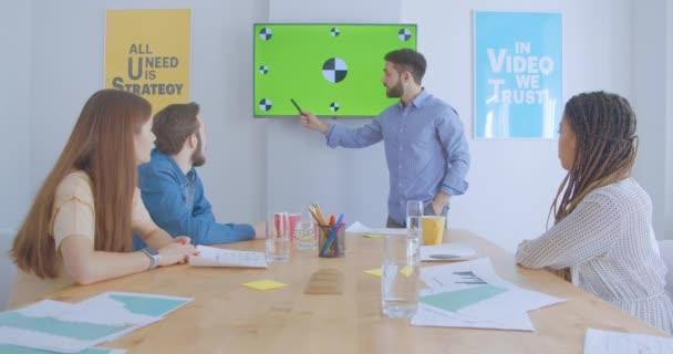Colleagues business presentation team plan discuss green screen meeting diverse multiraces confidence dreadlocks