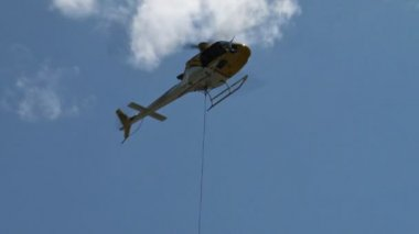 Firefighting helicopter delivering water