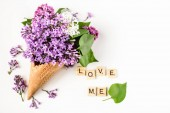 Flowers composition. Lilac in waffle cone. Flat lay, top view, copy space. Concept of proposal, love and tenderness.