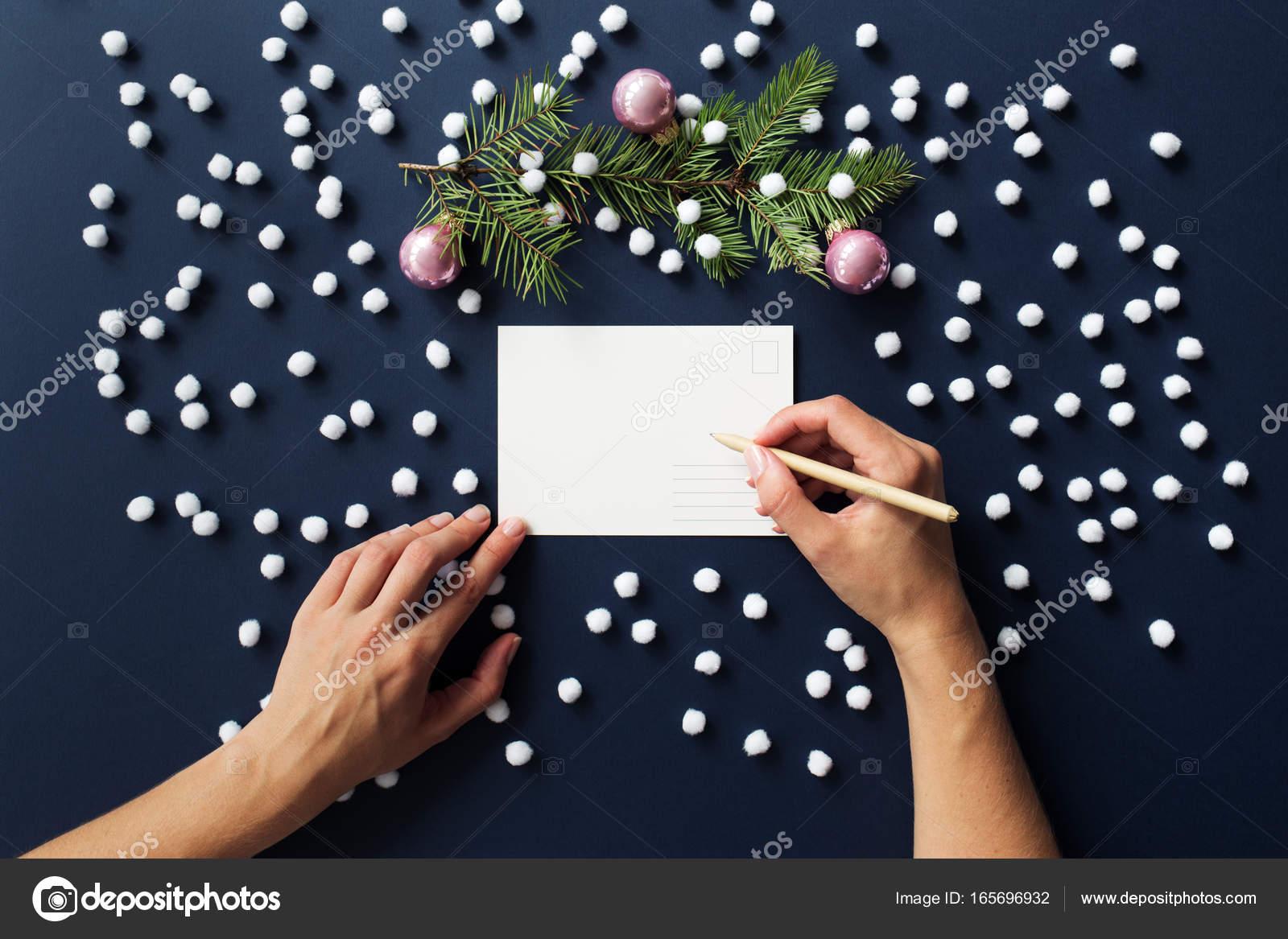Writing hand dark blue christmas card stock photo olliulli hands write on christmas card snowy dark blue background spruce branch with pink christmas ball photo by olliulli m4hsunfo