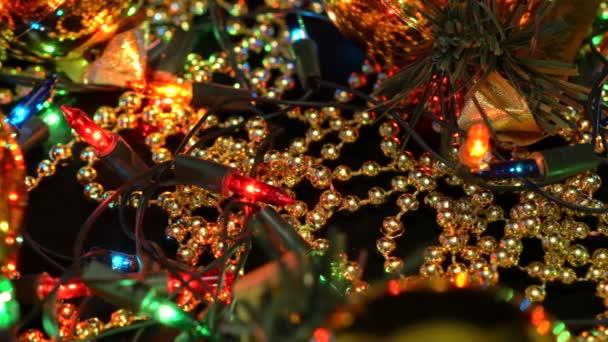 Christmas decorations shot close-up. Gold balls, garlands and beads