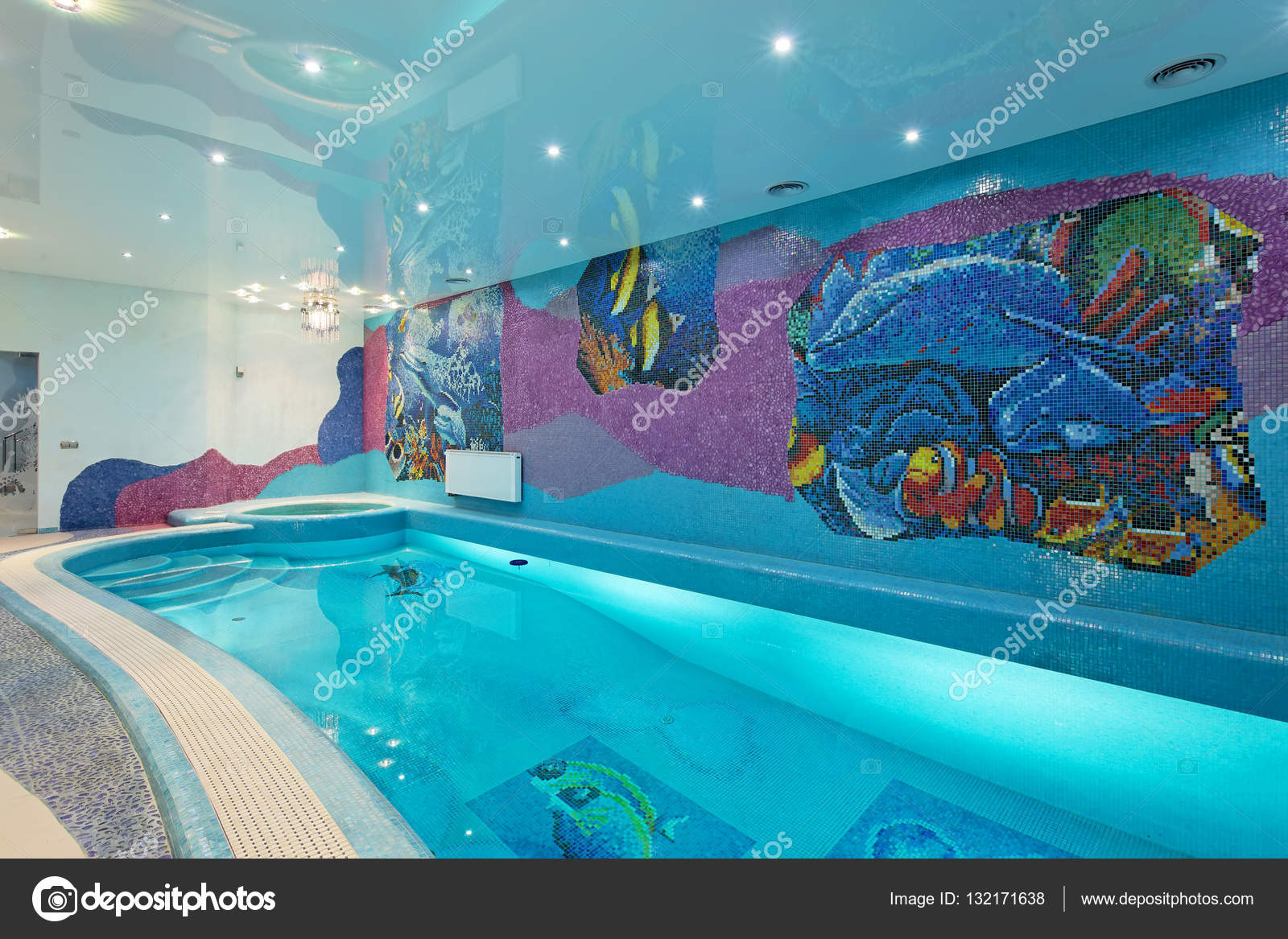 Spa swimming pool design with mosaic fish on the wall — Stock Photo ...