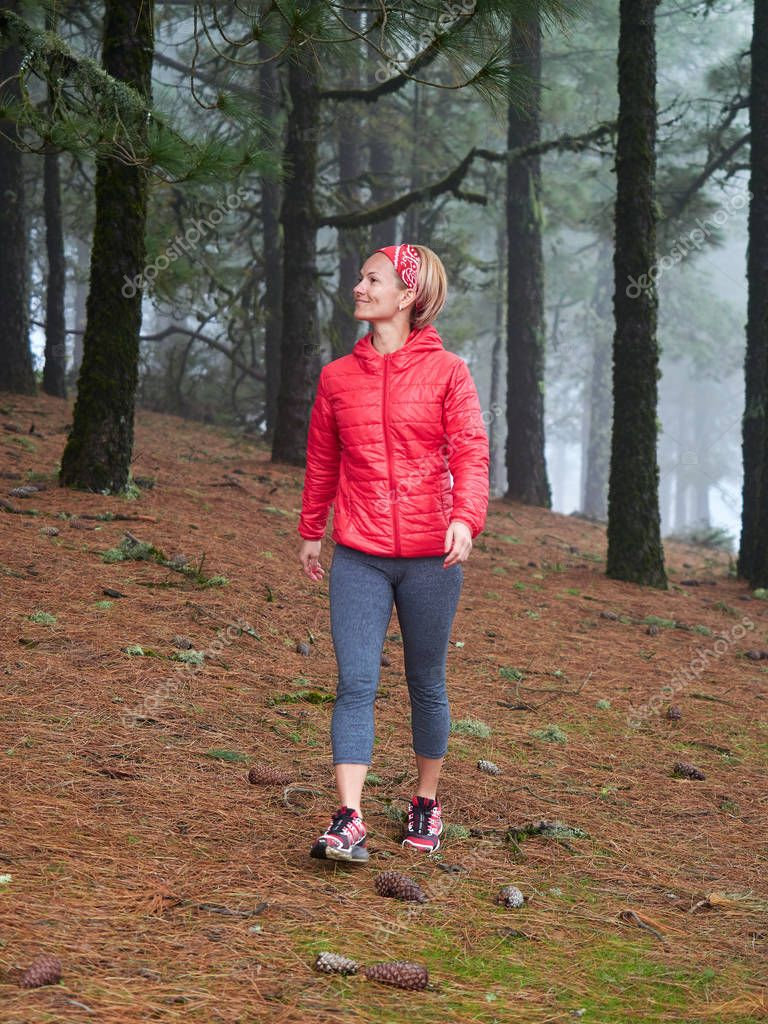 woman exploring stunning foggy forest