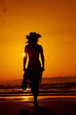young woman silhouette on the beach