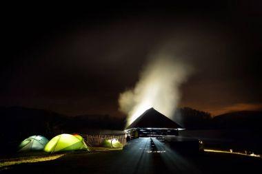 illuminated camping tents at night in alpin zone