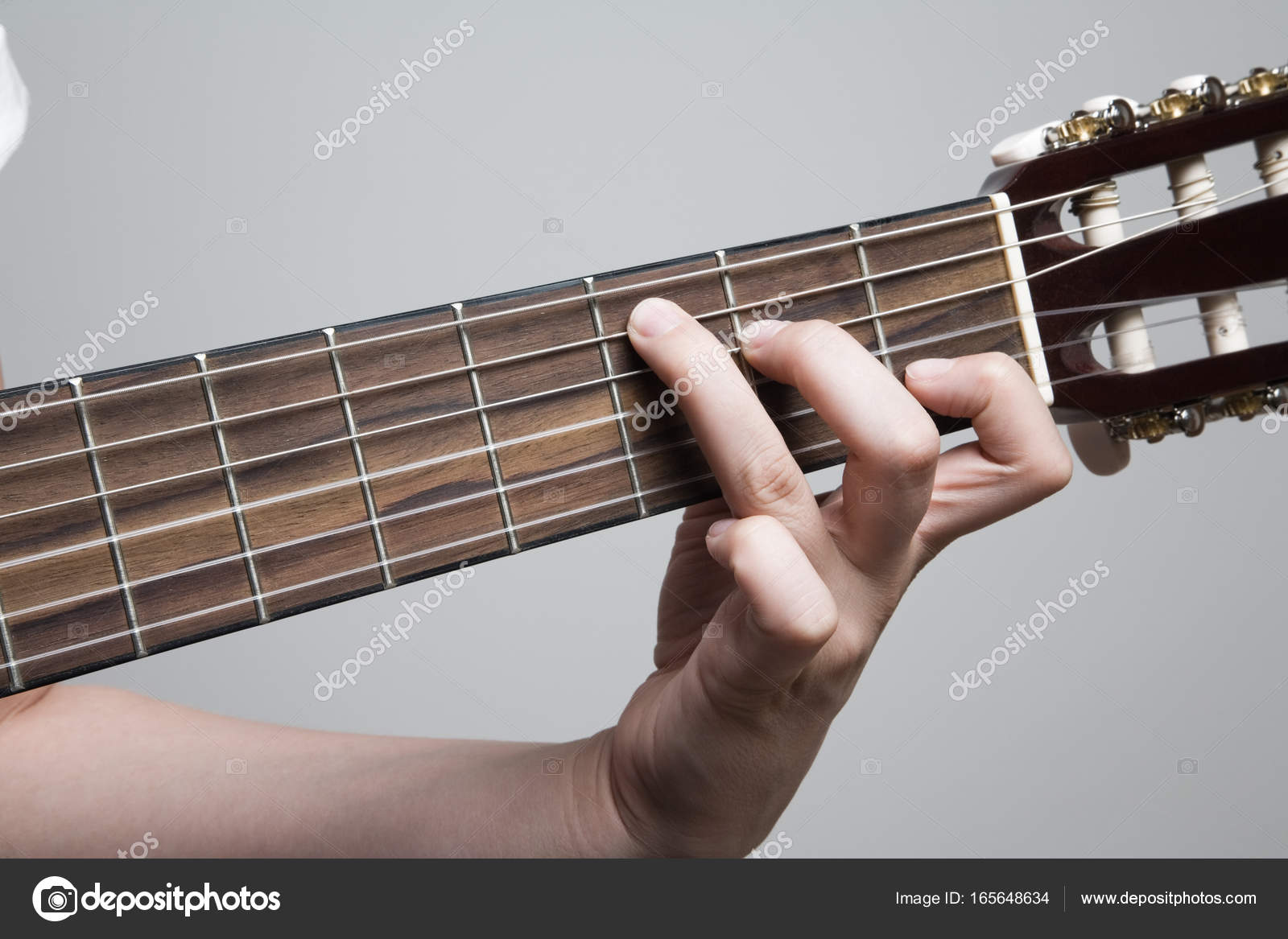 Music Guitar Griffin And Hand Guitar Chord C Stock Photo