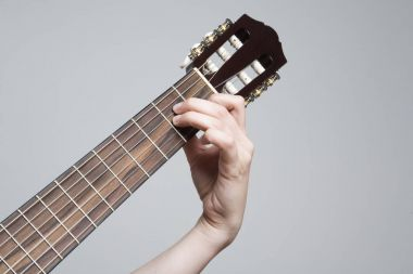 Music, guitar griffin and hand Guitar chord Am