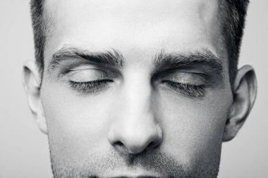 Men's eyes closed