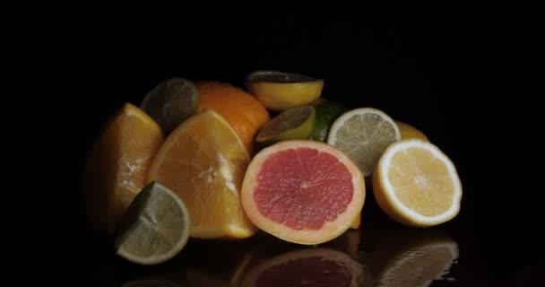 Citrus fruits, lemon, orange, lime, grapefruit, black background.