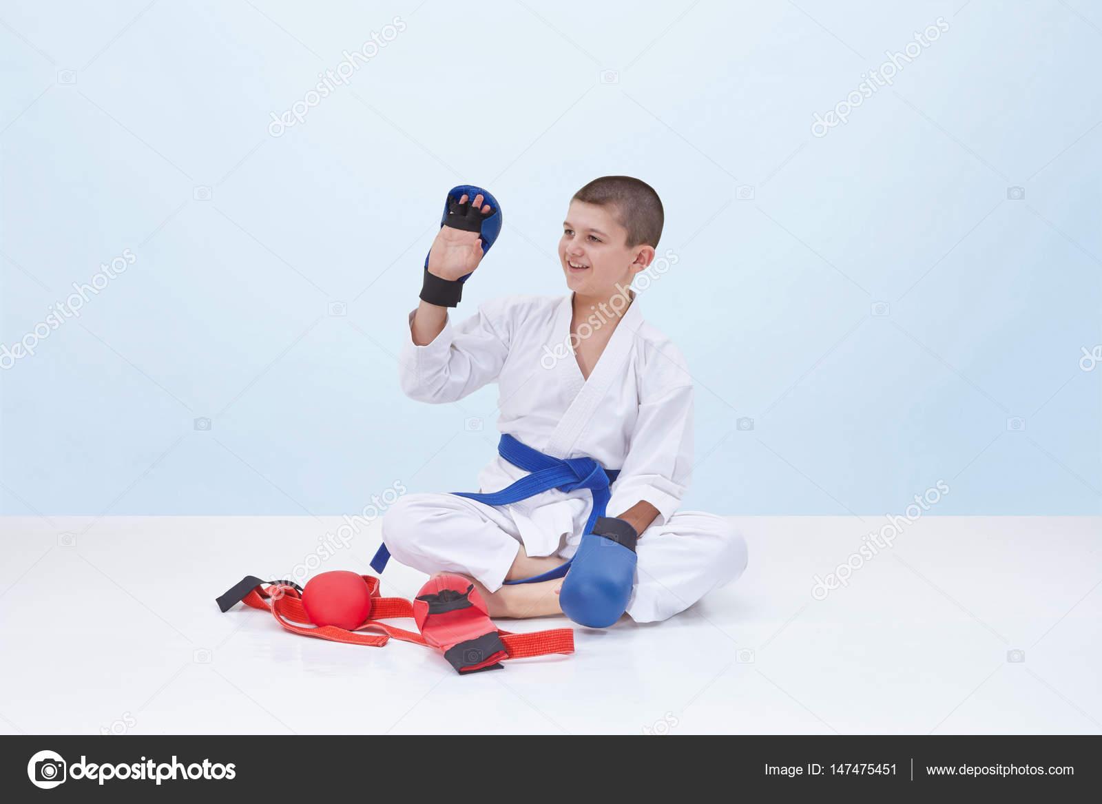 Karate boy in karategi raised his hand in greeting stock photo karate boy in karategi raised his hand in greeting stock photo m4hsunfo
