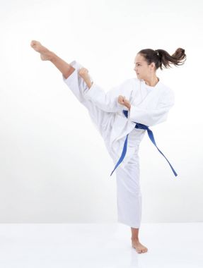 High kick kicking girl in karategi