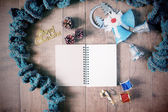 Flat lay of winter scraft, empty notebook, Christmas decoration