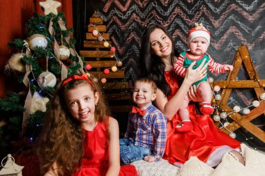 Mother with kids in a Christmas photo session