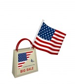 Photo Shopping bag with Sale advertisement and American flag