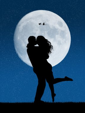 lovers kissing in the moonlight
