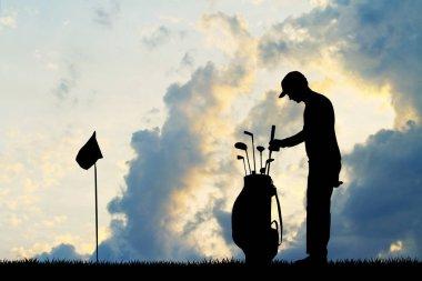 man golfer silhouette at sunset