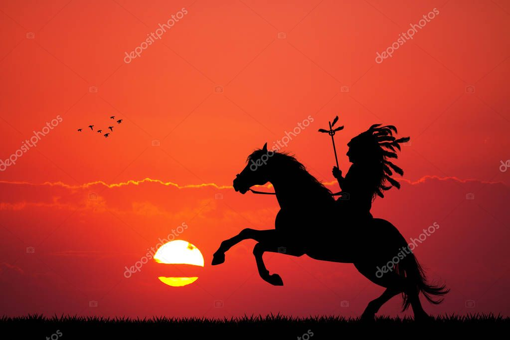 Indian on horseback at sunset