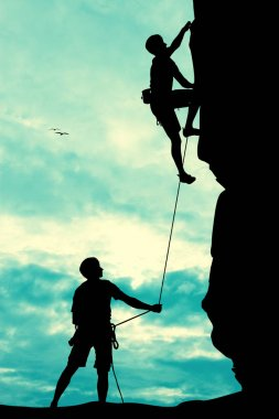 Free climbers at sunset
