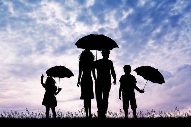 family in the rain at sunset