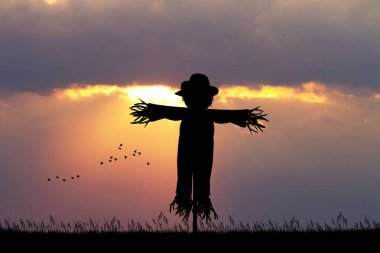 scarecrow at sunset