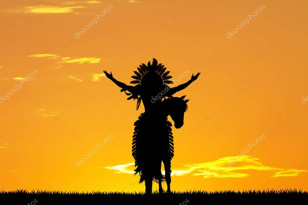 Native American Indian on horseback at sunset