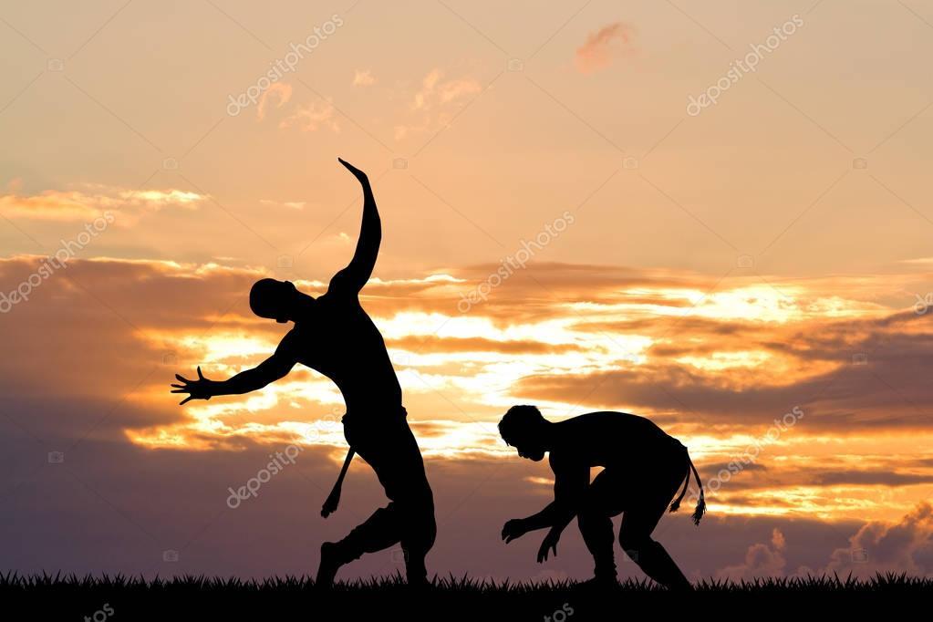 Capoeira, martial art at sunset
