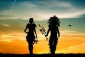 Pár indiánů při západu slunce