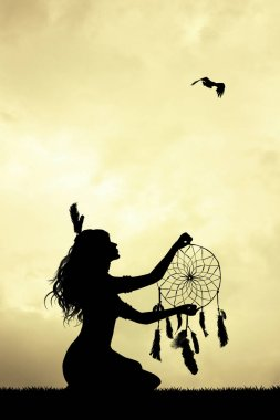 girl with dreamcatcher at sunset